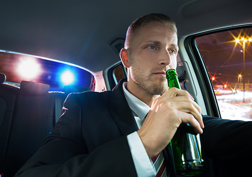 Young Man Drinking Beer And Pulled Over By Police for a DUI